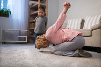 Cheerful grandmother and granddaughter making exercises