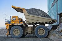 BELAZ-75131 mining dump truck discharging a load of copper ore, Erdenet Mining Corporation EMC,