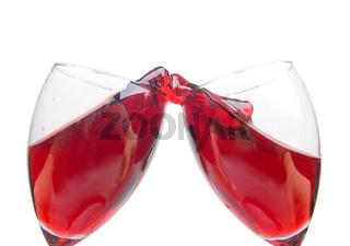 clink glasses, red wine splash