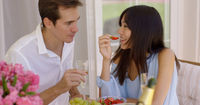 Couple sipping wine and eating fruit