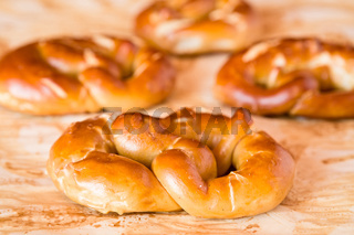 Cooked pretzel over the greaseproof paper