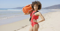 Female posing with rescue float on beach