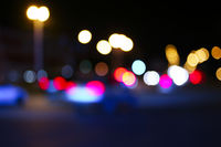 Retro toned blurred street and car lights, urban abstract night time background