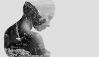 Silhouette of a naked woman combined with a rocky coast and sea. Double exposure, isolated on a white background. Black and white