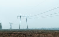 High voltage lines and power pylons in in the countryside in the early spring on the outskirts
