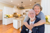 Senior Couple Hugging Inside Custom Kitchen