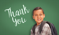 Hispanic Boy in Front of Chalk Board with Thank You Written On It