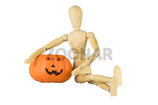 Wooden mannequin posing with a pumpkin