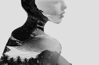 Silhouette of a naked woman combined with a tropical beach and sea. Double exposure. Black and white.