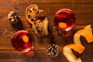 Alcoholic punch drink, dried orange fruit and pine cone