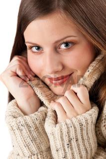 Portrait of beautiful young woman wearing turtleneck