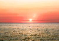 Beautiful blazing sunset landscape on a sea