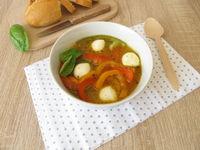 Homemade bell pepper soup with mozzarella
