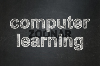 Learning concept: Computer Learning on chalkboard background