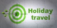 Vacation concept: target and Holiday Travel on wall background