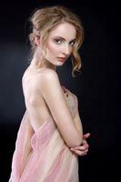 beautiful woman draped in transparent dress.