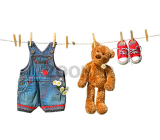 Children's clothes with teddy bear on clothesline