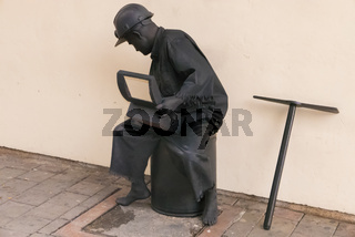 living statue representing miner