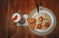 Fried eggs in a plate on a wooden table, selective focus, top view