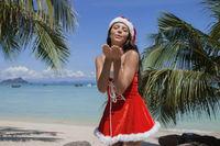 Mrs. Claus on tropical beach