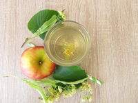 Freshly made lemonade with tilia flowers and apple juice