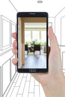 Hand Holding Smart Phone Displaying Photo of House Hallway Drawing Behind