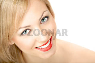 Portrait of the smiling blonde on a white background