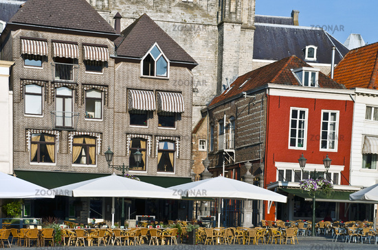 Outdoor restaurant in holland square in central old town with furniture