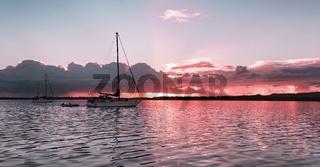 Peaceful pale pink sunrise seascape Australia