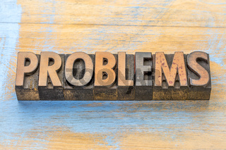 problems - word abstract in wood type