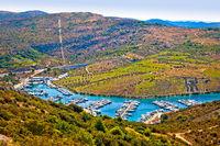 Marina in bay near Primosten aerial view
