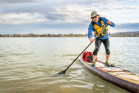expedition stand up paddleboard on lake