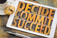 Decide, commit, succeed word abstract on tablet