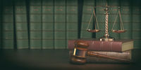 Gavel and scale on the background of vintage lawyer books. Concept of law and justice.