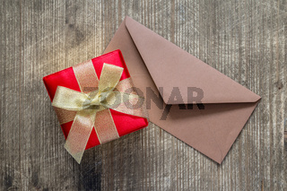 Gift and envelope on the table