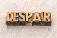 despair word abstract in wood type