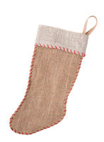 A homemade rustic burlap Christmas Stocking isolated on white.