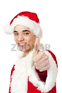 Lachender Jugendlicher als Nikolaus verkleidet zeigt Daumen nach