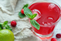 Glass with homemade cranberry morse closeup.