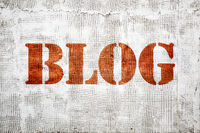 blog word graffiti on plaster wall