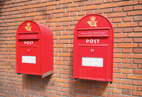 Red mail boxes on brick wall