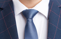 Blue necktie and checkered elegant suit