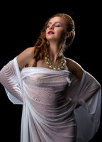 Chic and seduction. Pretty model posing in jewelry