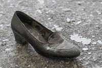 Women's shoe in ailing environment