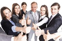 Business team showing thumb up