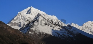 Sunder Peak and other high mountains seen from a place near Namche Bazaar, Nepal.