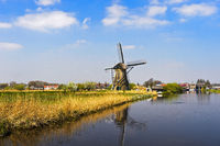 Dutch Windmill at a canal, Netherlands