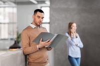 male office worker with folder