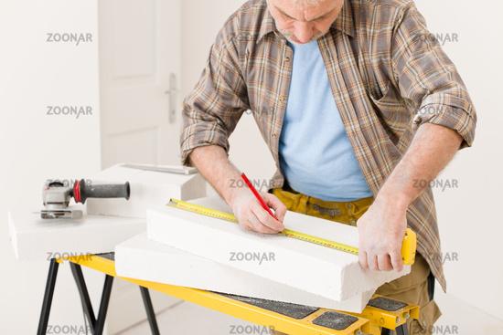 Home improvement - handyman measure porous brick