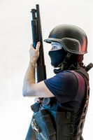 Violence, man armed with balaclava and bulletproof vest, gun and shotgun, kalashnikov